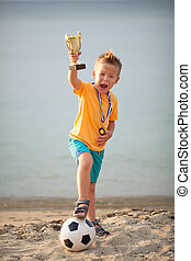 Young Boy Celebrating Championship Soccer Win