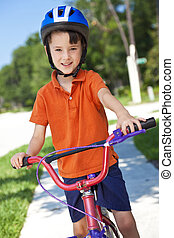 Young Boy Child Cycling on His Bicycle