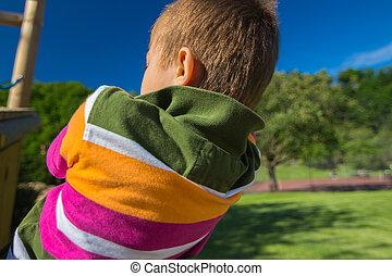 young boy climbing