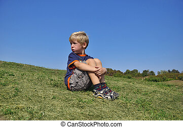 Young blond boy desperation body language