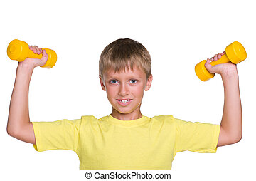 Young boy does exercises with dumbbells
