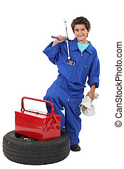 Young boy dressed as a mechanic