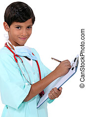Young boy dressed as a medic with a clipboard