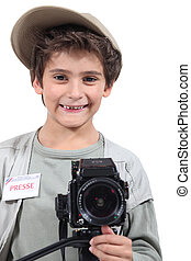 Young boy dressed as a press photographer