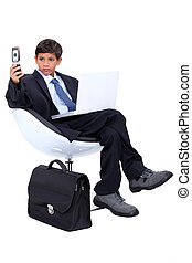 Young boy dressed as a surly businessman