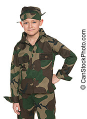 Young boy dressed in camouflage