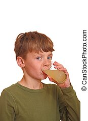 Young boy drinks juice