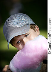cotton candy - young boy eating blue and pink cotton candy
