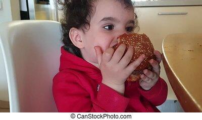 Young boy eating home-made hamburger shot clip