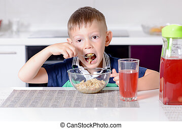 Boy Eating Oatmeal Cereal for Breakfast