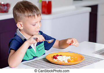 Young Boy Eating Plate of Cheese and Fruit - Young Blond Boy...
