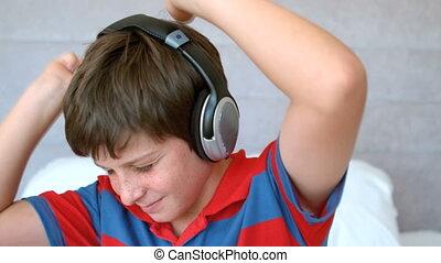 Young boy enjoying music with headp