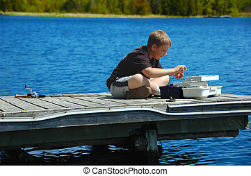 Young Boy Fishing - Young boy getting ready to go fishing