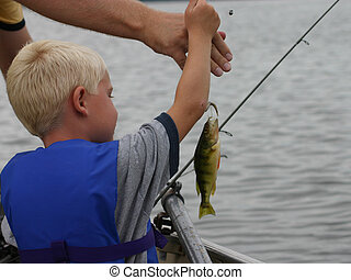 Young boy Fishing - Young Boy Fishing caught a fish dad...