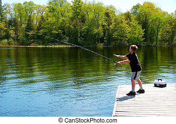 Young Boy Fishing  - Young boy fishing from a dock