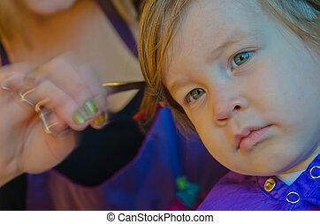 Young boy getting a hair cut