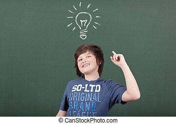 Young boy has an idea at school