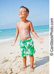 Young boy having fun at the beach