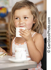 Young Boy Having Tea at Montessori/Pre-School
