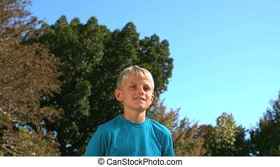 Young boy heading a football
