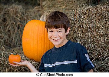 Boy Holding a Little Pumpkin