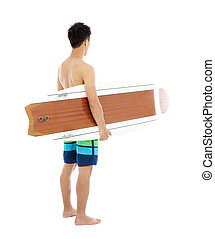 young boy holding a surfboard over white background
