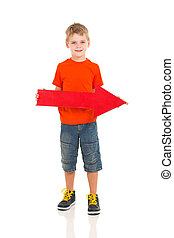young boy holding direction arrow