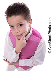 Young boy holding his chin in his First Holy Communion looking from above