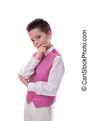 Young boy holding his chin in his First Holy Communion on white background