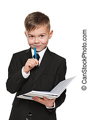 Young boy in black suit with a notebook