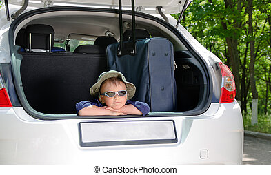 Young boy in car