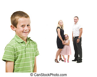 Young boy in front of his family