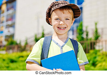 Young boy in front of school