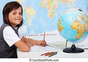 Young boy in geography class
