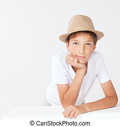Young boy in hat.