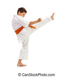 Young boy in kimono making kick - Young boy with kimono and...