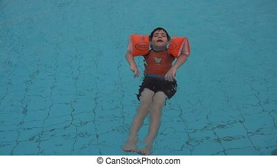 Young boy in the water at resort hotel