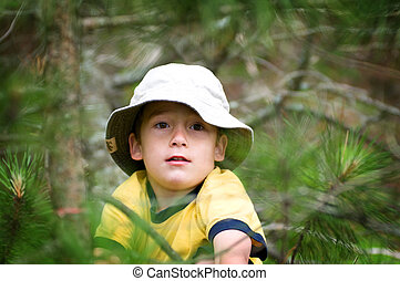 young boy in the woods