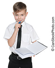 Young boy in white shirt with a notebook