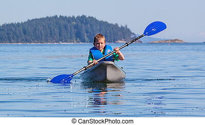 young boy kayaking