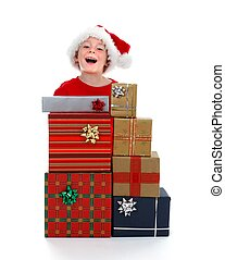 Young boy laughing behind gifts
