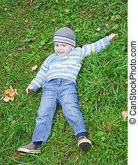 boy laying on grass