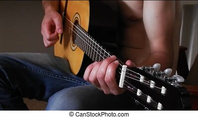 young boy learning to play guitar