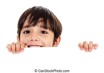 Young boy lifting his head out of the blank board