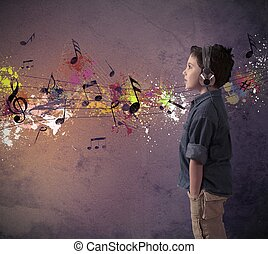 Young boy listening to music - Concept of young boy...