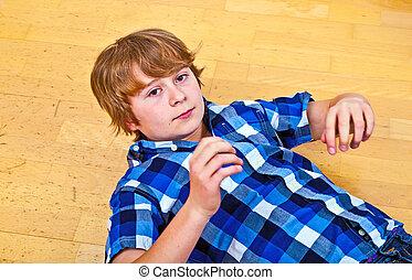 boy lying at the floor