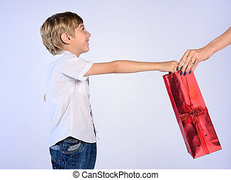 young boy offer gift to woman