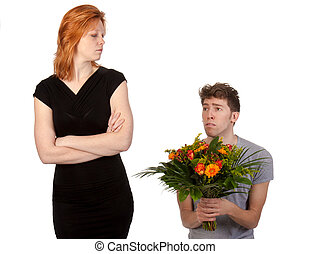Young boy offering a bunch of flowers to his angry ...