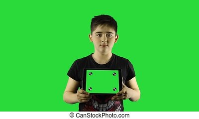 Young boy on chroma key using smart device