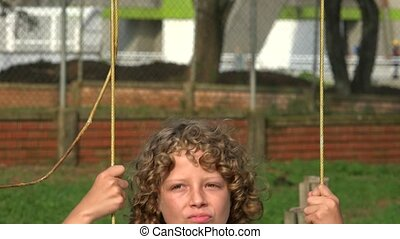 Young Boy On Swingset